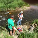 Amigos Bravos volunteers sampling water in the Rio Fernando